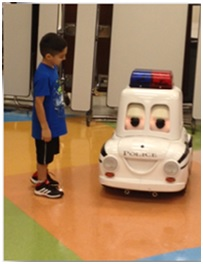 Student with large toy car